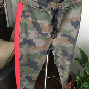 Camo and red joggers.